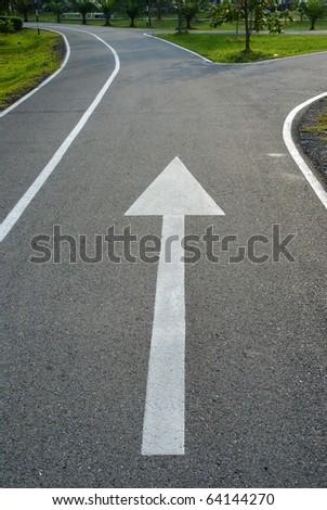 Road sign, white arrow - stock photo