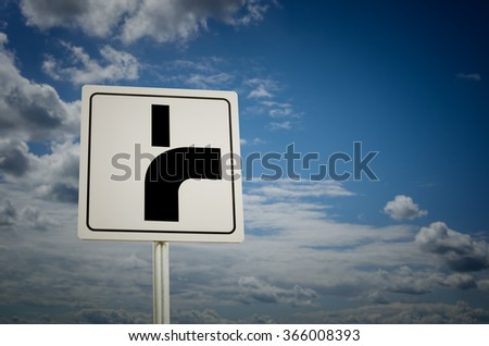 Road sign with cloudy sky background. Main road bends to the right. - stock photo