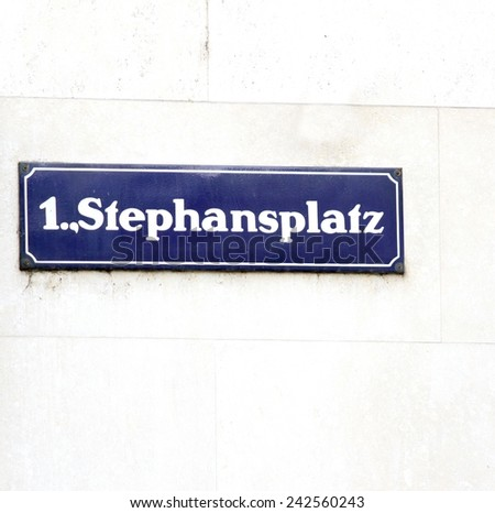 road sign with the name of the square in vienna in austria - stock photo