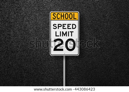 Road signs. Behind the signs one can see a smooth asphalt road. Speed limit. School. The texture of the tarmac, top view. - stock photo