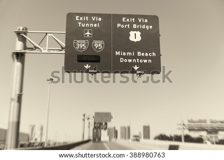 Road signs in Miami from a moving vehicle. - stock photo