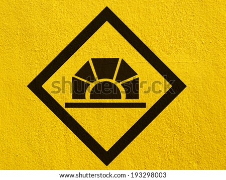 road signs painted on a stucco wall outside - stock photo