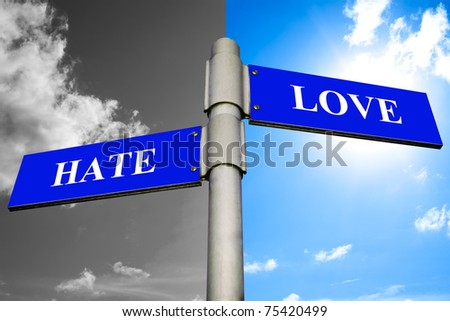 Road signs showing the ways to HATE and LOVE. - stock photo