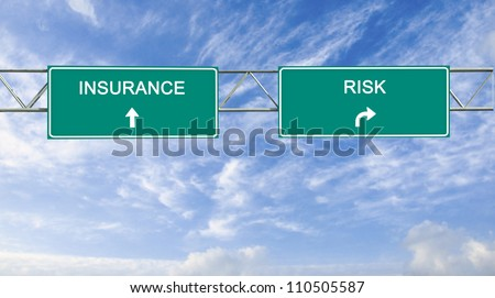 Road signs to insurance and risk - stock photo