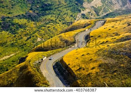 Road snaking through landscape - stock photo