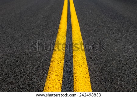 Road texture with two yellow stripes - stock photo