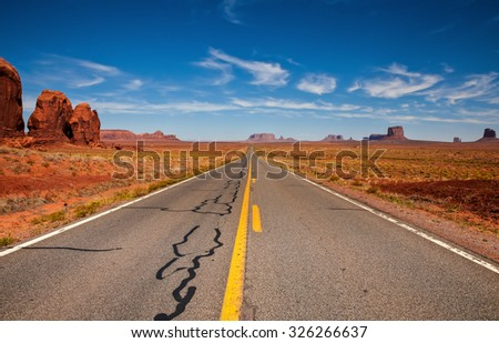 Road that leads us straight to Monument Valley - stock photo