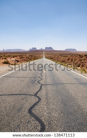 Road that takes us to Monument Valley called Highway 163. It is a region characterized by a cluster of vast sundstones buttes, it i?s located between Arizona and Utah, United States of America. - stock photo