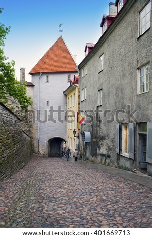 Road through a tower in old Tallinn - stock photo