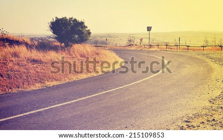 Road through African country side at sunset time in retro style - stock photo