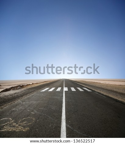Road through desert in Tunisia - stock photo