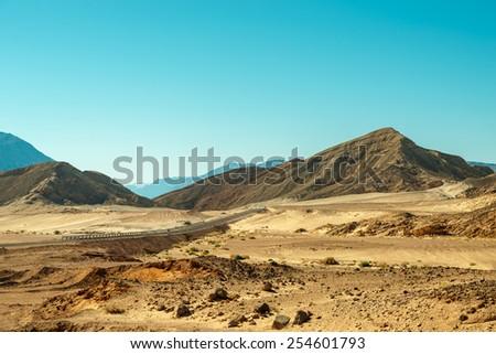 Road through desert with mountains, Sinai, Egypt - stock photo