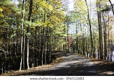Road Through Lake James State Park in the Fall. - stock photo