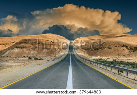 Road through stone desert of the Negev, Israel - stock photo