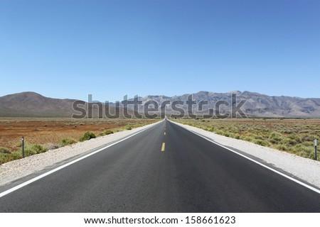 Road through the desert, California, USA - stock photo