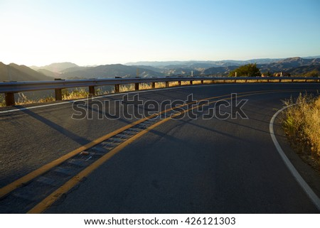 Road through the hills in Malibu at sunset - stock photo