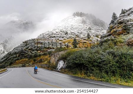 Road to Huanglong National Park near Jiuzhaijou valley after snowfall - SiChuan, China - stock photo