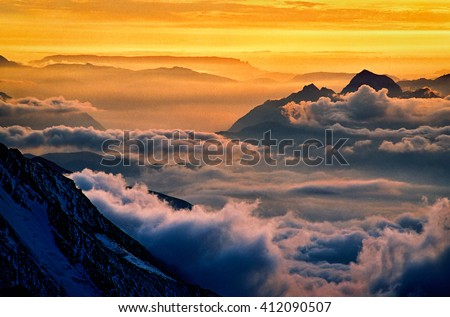 Road to Mont Blanc. Chamonix valley in the clouds. France - stock photo