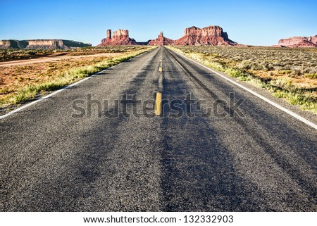 road to Monument Valley with blue sky - stock photo