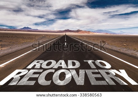 Road to Recovery written on desert road - stock photo