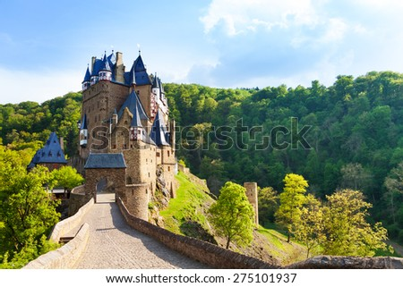Road to the Eltz castle with towers, in hills - stock photo