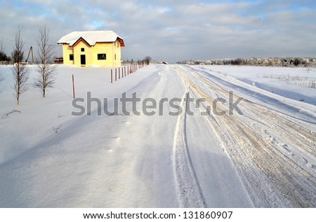 road to the house in winter landscape - stock photo
