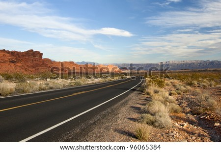 Road to the Open Land A road inside the Valley of Fire national park that leads to an open land. The road is really beautiful; the photo can be use by people who is trying to show a pretty road. - stock photo