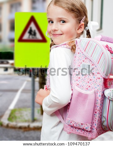 Road to the school - outdoor portrait of  lovely schoolgirl on a pedestrian crossing - stock photo