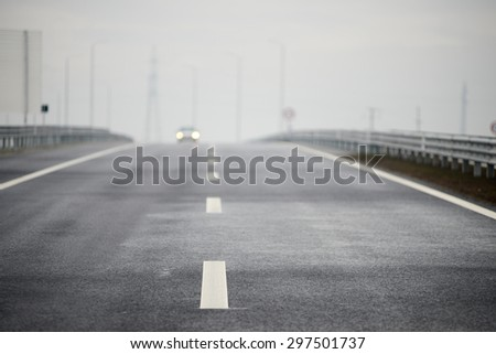 Road tracks and Car headlights Blurred on background - stock photo