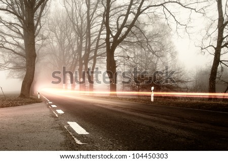 road traffic with fog, fog in autumn, on the road - stock photo