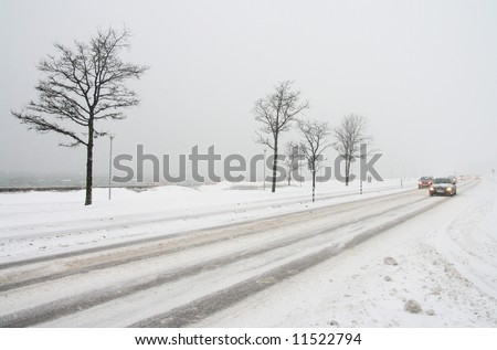 Road transport in the winter in a snowfall. - stock photo