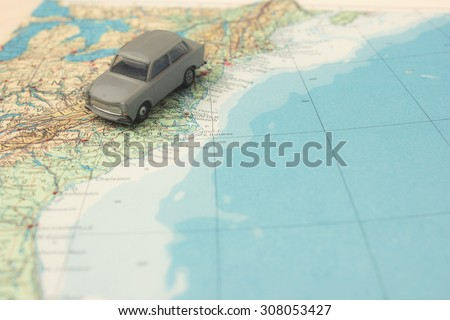 Road trip - car driving along the east coast on a map - stock photo