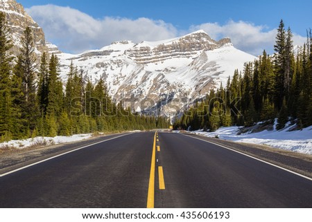 Road Trip in the Rocky Mountains. Picture taken in Icefields Pkwy, Alberta, Canada, near Banff. - stock photo
