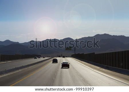road trip to mountain in bright sunny day - stock photo
