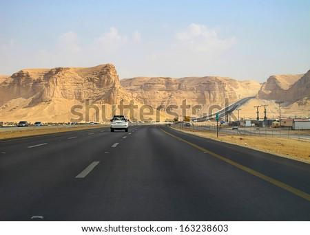 Road trough the desert Riyadh-Makkah (Mecca) highway in Saudi Arabia                                - stock photo