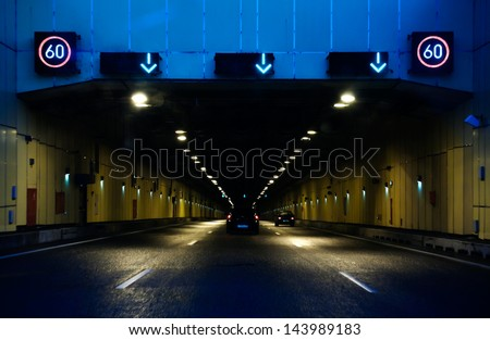 road tunnel with speed limitation - stock photo