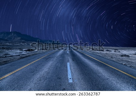 road under the stars  - stock photo