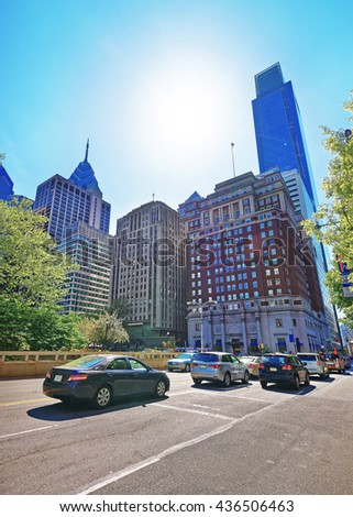 Road view on Penn Center with skyline of skyscrapers in Philadelphia, Pennsylvania, USA. It is a central business district in Philadelphia. Traffic on the road. - stock photo