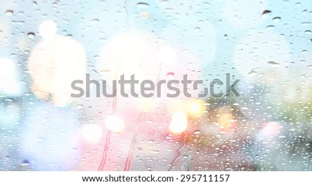 Road view through car window with rain drops  - stock photo