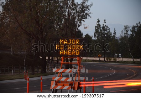 Road warning sign with message/Traffic Warning/Lighted sign warn of construction and danger - stock photo