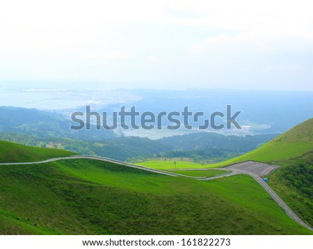 Road winding through mountains on a clear day. - stock photo
