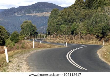 Road winding through the East Coast of Tasmania, Australia - stock photo