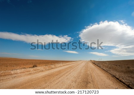 road with clouds - stock photo