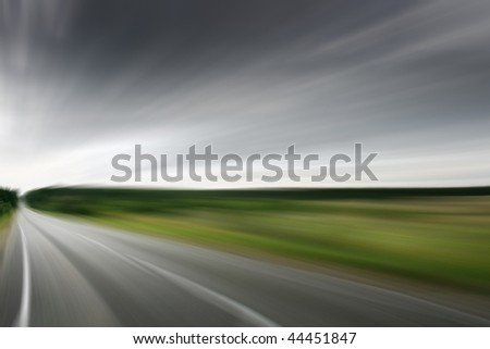 Road with motion blur. - stock photo