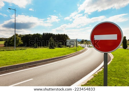 road with road sign prohibiting - stock photo
