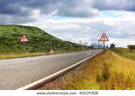 Road with road signs in Scotland, summertime - stock photo