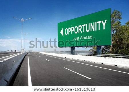 road with sign of opportunity. conceptual image - stock photo