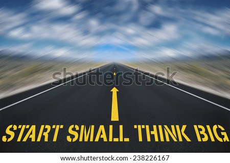 road with sign start small think big concept - stock photo