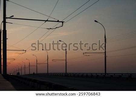 Road with street lamps at sunset. - stock photo