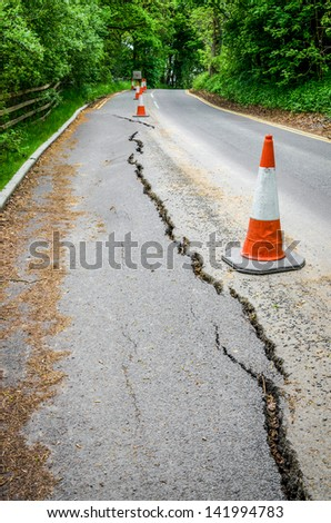 Road works on cracked tarmac from subsidence - stock photo